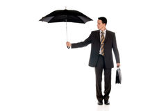 Businessman insurance agent. Handsome businessman,  insurance agent with umbrella.  Studio, white background Royalty Free Stock Images