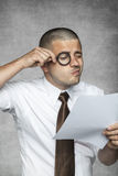 Businessman intently reads the contract. Business man intently reads the contract Stock Photography