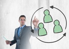 Businessman interacting and choosing group of people refresh icon. Digital composite of Businessman interacting and choosing group of people refresh icon Royalty Free Stock Photo