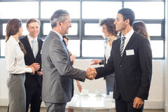 Businessman interacting with his team Stock Image