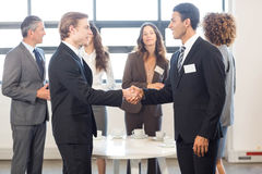Businessman interacting with his team Stock Photography