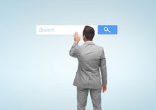 Businessman with internet browser search bar Royalty Free Stock Image