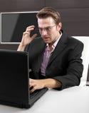 Businessman on the internet Stock Image