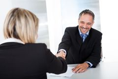 Businessman at the interview shaking hands Royalty Free Stock Photos
