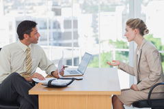 Businessman interviewing a businesswoman Stock Photography