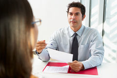 Businessman Interviewing Female Candidate Royalty Free Stock Photo