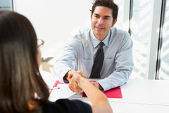 Businessman Interviewing Female Candidate Stock Photos