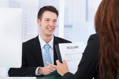 Businessman interviewing female candidate in office Royalty Free Stock Photos