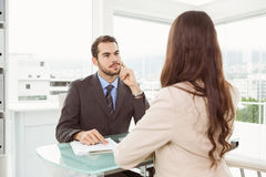 Businessman interviewing woman in office Royalty Free Stock Images