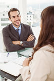 Businessman interviewing woman in office Royalty Free Stock Photos