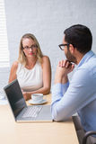 Businessman interviewing woman Royalty Free Stock Photo
