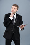 Businessman is intrigued by the news he is reading on his tablet pc Royalty Free Stock Photo