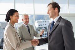 Businessman introducing a colleague Stock Photography