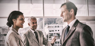 Businessman introducing a colleague Royalty Free Stock Photography