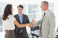Businessman introducing colleagues Stock Photography