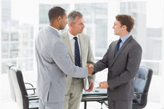 Businessman introducing new colleagues Stock Image
