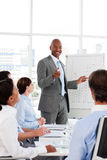 Businessman introducing stock market to his team Royalty Free Stock Image