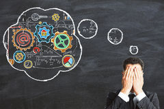 Businessman invents a business development plan Stock Photos