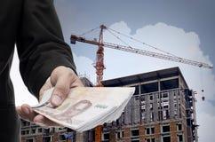 Businessman invest in condominium building Stock Images