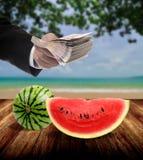 Businessman invest in fruit market Stock Image
