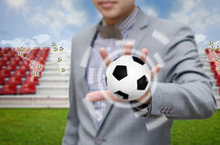 Businessman invest in soccer team Stock Photos