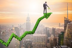 The businessman in investment concept watering financial line chart. Businessman in investment concept watering financial line chart Royalty Free Stock Images