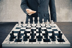Businessman invites to play a chess Royalty Free Stock Photos