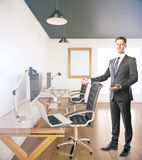 Businessman inviting to sit Stock Image