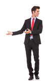 Businessman is inviting you to business. Young business man is welcoming and inviting you to business on white background Stock Images