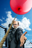 Businessman inviting you to fly up Stock Photography