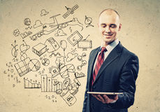 Businessman with ipad in hands Royalty Free Stock Photos