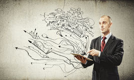 Businessman with ipad Royalty Free Stock Images