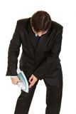 Businessman ironing business suit right on herself Stock Photo
