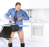 Businessman ironing his trouser Stock Photo