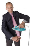 Businessman ironing tie isolated on white background royalty free stock photo