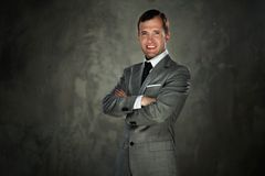 Businessman isolated on grey Stock Photography