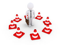 Businessman is isolated by traffic cones Stock Photos