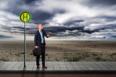 Businessman ist waiting at the bus station stock photos