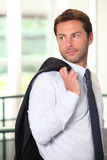Businessman with jacket over shoulder Stock Photo
