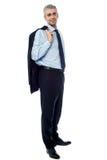 Businessman with jacket over shoulder Stock Image