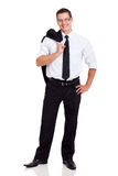 Businessman jacket on shoulder Stock Photos