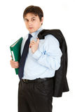 Businessman with jacket on shoulder holding folder Stock Images