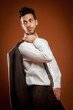 Businessman with jackt over his shoulders Stock Photo