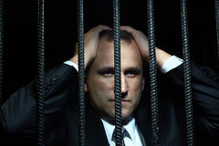 Businessman in jail Stock Photography