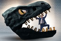 The businessman in the jaws of debt and loan. Businessman in the jaws of debt and loan stock images