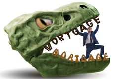 The businessman in the jaws of debt and loan. Businessman in the jaws of debt and loan royalty free stock image