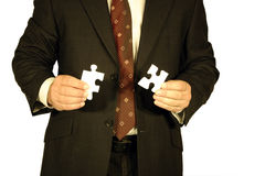 Businessman with jigsaw Royalty Free Stock Photography
