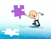 Businessman with jigsaw Royalty Free Stock Photos
