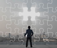 Businessman with jigsaw screen, business strategy Stock Photography