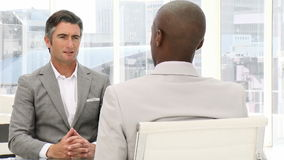 Businessman at a job interview. In the office stock footage